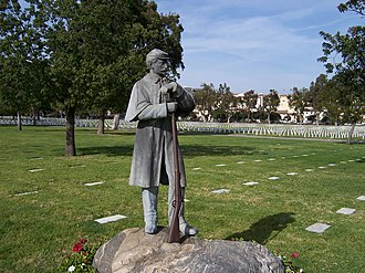Los Angeles National Cemetery - A bronze soldier standing at parade rest is perched atop a boulder to honor Civil War soldiers, erected in 1942.