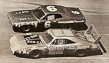 This is a picture of a battle going on between Pete Hamilton (in the #6 vehicle) and Dick Brooks (in the #22 vehicle) at the 1971 running of the Daytona 500.