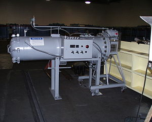 Autoclave (industrial) - Small autoclave with electric heat, used in the manufacture of advanced composite parts. This autoclave features a low-cost manual-latch door design. Note the removable works-on-a-trolley back end.