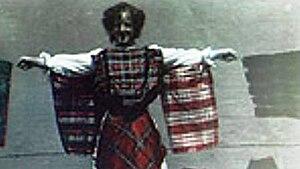 Woman Draped in Patterned Handkerchiefs - Screencap from the film