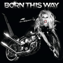 "Grayscale image of a bike against a black background. The bike has a blond woman's head at its front, whose right hand stretches out to the front tires of the bike. The words ""Born This Way"" is embossed above the image."