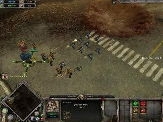 Warhammer 40,000: Dawn of War - A squad of Space Marines engage a group of Orks next to a Strategic Point.
