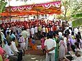 Devotees gather for the Palkhi Miravnuk (Palanquin Procession).jpg