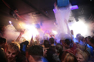 Foam party -  Dancing at a foam party; the blue object on the ceiling is a foam generator.