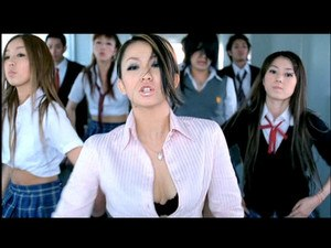 "Butterfly (Kumi Koda song) - Scene in ""Butterfly"" video with Kumi shown in a high school hallway."