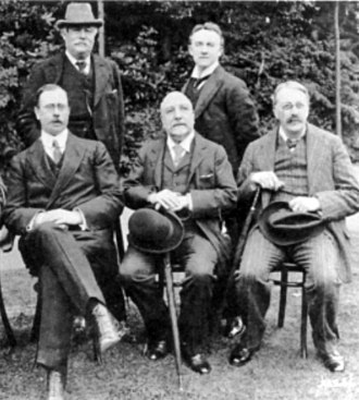 Joseph Bennett (critic) - Parry (back l.), Mackenzie (front c.) and Stanford (front r.) in 1910, with Edward German (back r.) and Dan Godfrey
