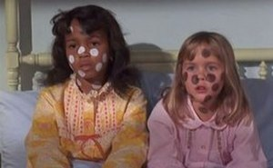 Sisters at Heart - Lisa (left) and Tabitha (right) after Tabitha has cast a spell so both of them have both black and white skin