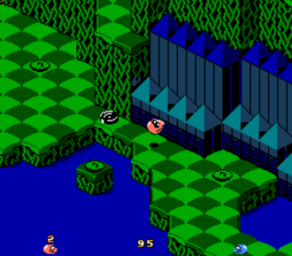 """Snake Rattle 'n' Roll - Snake Rattle 'n' Roll features a 3D isometric playing field in which the snakes must avoid obstacles, collect items, and eat """"Nibbley Pibbleys""""."""