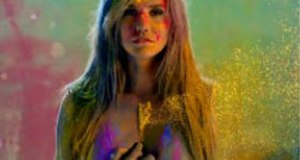 "Take It Off (Kesha song) - A still of the music video that shows Kesha ""unzipping"" herself, transforming into stardust. The scene is intended to be symbolic with the transformation representing letting go of one's inhibitions."