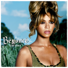Album cover which shows a young woman in a low cut dress, with dark eye liner and hair piled high on her head.