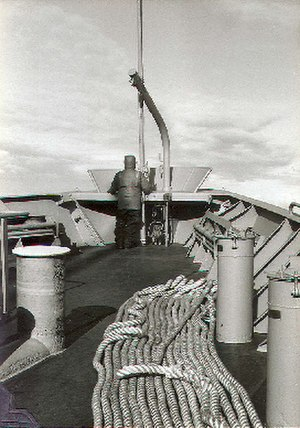 Maritime transport - An able seaman stands iceberg lookout on the bow of the freighter USNS Southern Cross during a re-supply mission to McMurdo Station, Antarctica; circa 1981.