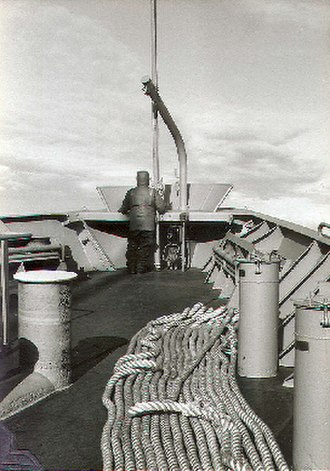 Sailor - An able seaman stands iceberg lookout on the bow of the freighter USNS Southern Cross during a re-supply mission to McMurdo Station, Antarctica; circa 1981.