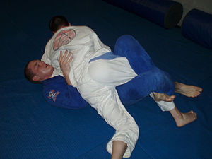 Half guard - A fighter working to pass half guard in Brazilian Jiu-Jitsu sparring