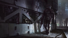 Low angle shot of an industrial area. An armored soldier carrying a weapon looks over his shoulder. Harsh lighting cuts through the gloomy darkness and illuminates the soldier, casting shadows on the wall behind him.