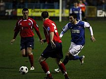 Hyde (in red) play Stalybridge in 2012