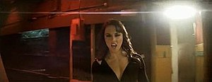 The Moment You Believe - Melanie C in a music video scene, where Melanie C is seen roaming around the studio.