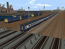 Trainz revolvy screenshot of trs2004 or trainz railroad simulator 2004 in driver mode showing third party british rolling stock in a rail yard scene fandeluxe Choice Image