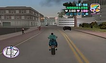 Gameplay screenshot of the player character driving a motorcycle through a busy city street.