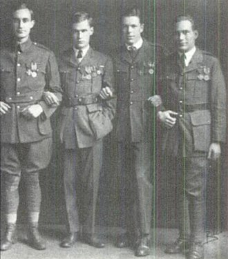 """Harry Crosby - (L-R) Philip ('the Vulture"""") Shepley, Harry Crosby, George Richmond (""""Tote"""") Fearing, and Stuart Kaiser shortly after Armistice Day, 1919, displaying their decorations."""