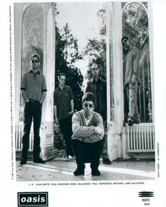 Oasis (band) - Oasis, 1997. L–R: Alan White, Paul McGuigan, Noel Gallagher, Paul Arthurs and Liam Gallagher.