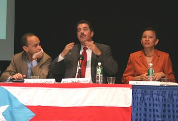 Stateside Puerto Rican Members of the United States Congress: Luis Gutierrez (D-IL)(left), José Serrano (D-NY)(center), and Nydia Velazquez (D-NY)(right) speaking at the Encuentro Boricua Conference at Hostos Community College in New York City, 2004