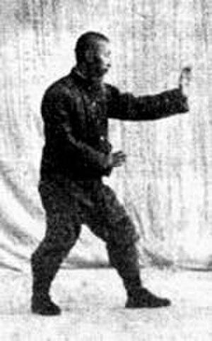 Sun Lutang - Sun Lu-t'ang standing in Xingyiquan's San Ti Shi stance.