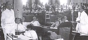 Senate of the Philippines - The post-World-War-II Philippine Senate in 1951: Cipriano P. Primicias, Sr., far left, debates Quintín Paredes, far right. In the middle are Justiniano Montano, Mariano Jesús Cuenco, Enrique B. Magalona, and Francisco Delgado; in the foreground is Edmundo Cea. Deliberations were once held at the Old Legislative Building.