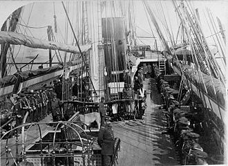 Yates Stirling - USS Lackawanna, crew at quarters for inspection, circa September 1880 to September 1881.
