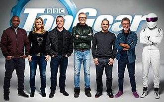 Top Gear (2002 TV series) - The presenters of Top Gear (series 23), from left to right: Rory Reid, Sabine Schmitz, Matt LeBlanc, Chris Evans, Chris Harris, Eddie Jordan, and The Stig