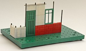 Bayko - Basic construction elements: base, rods and bricks, from a Plimpton era Bayko set.