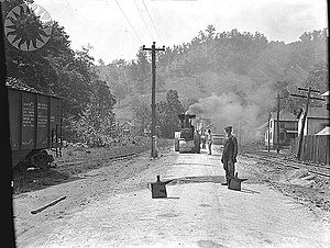 Macadam - New macadam road construction at McRoberts, Kentucky: pouring tar. 1926