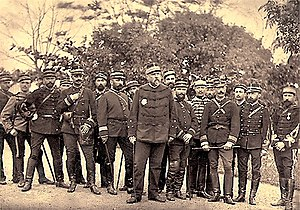 Louis Brière de l'Isle - General Brière de l'Isle and his staff on the eve of the Lang Son Campaign.  General François de Négrier (with hand on chest) and Lieutenant-Colonel Paul-Gustave Herbinger (clasping cane in both hands) are in the front row.