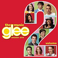 "Photographs of ten people on a multicoloured background fill in a large Arabic numeral ""2"" to the right. The word ""Glee"" is in lowercase white to the left. In lowercase yellow font are the words ""The Music"" (above ""Glee""), ""Season One"" (below ""Glee""), and ""Volume"" (beside the ""2"")."