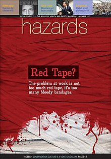 "Interwoven strips of cloth mostly stained red, fading to white near the foot of the image. The caption says ""Red tape? The problem at work is not too much red tape, it's too many bloody bandages""."