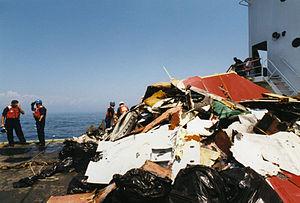 USCGC Juniper (WLB-201) - Wreckage recovered from TWA Flight 800, on the deck of Juniper
