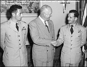 "Joseph C. McConnell - Air Force aces Joseph McConnell and Manuel ""Pete"" Fernandez meet with President Dwight D. Eisenhower at the White House in May 1953."