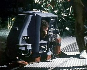 Silent Running - With its cover-plate removed during a shooting break, double-amputee actor Mark Persons is visible inside the tiny Drone 1 (Dewey) costume.