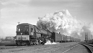 """Southern Pacific Railroad #4274, a type 4-8-8-2 """"cab-forward"""" steam locomotive, leads a California-Nevada Railroad Historical Society excursion out of Reno, Nevada in December of 1957."""