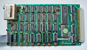 RF modulator - The motherboard of an early microcomputer, the Microtan 65, showing the silver-cased ASTEC 1111EM36 UHF TV modulator at top left