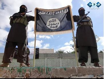 AQAP guards outside of a building