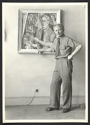 A. S. Baylinson - A. S. Baylinson with self-portrait painting, 194?. Unidentified photographer. A. S. Baylinson papers, Archives of American Art, Smithsonian Institution.