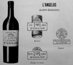 Château Angélus - Then named L'Angélus presentation card dated 1931, demonstrating the designs of the early 20th century, the label, cork, case and capsule markings.