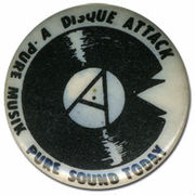 Button Badge created by Cook (circa 1979) for his band Disque Attack in which he played drums and for whom he was later lead vocalist.