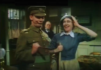 "Ruby Finch - The kitchen maid Ruby Finch dressed like a ""soldier"", saluting and holding the salute"