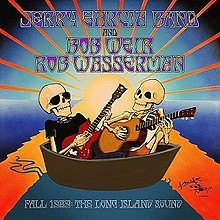 Two skeletons sit in a small boat, with the rays of the setting sun behind them.  One skeleton is wearing sunglasses, a black t-shirt, and dark pants, and playing an electric guitar.  The other is wearing a sleeveless t-shirt and shorts, and playing an acoustic guitar.