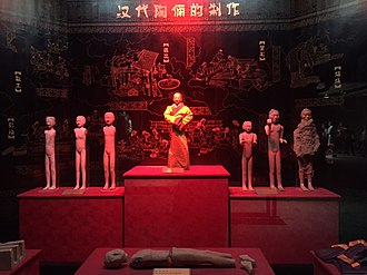 Han Yang Ling - Exhibit at Han Yang Ling Mausoleum. The figurine in the middle shows how it originally look like at time of burial. The one on the extreme right shows a partially excavated figurine