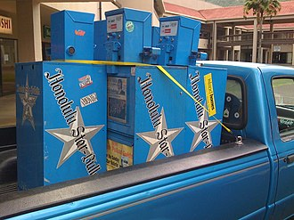 Honolulu Star-Bulletin - The Star-Bulletin vending machines being hauled away on the last day of circulation