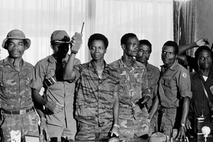 1980 Liberian coup d'état - Doe (center) holding a walkie-talkie, alongside the other conspirators during the 1980 coup.