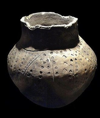 Anglo-Saxon settlement of Britain - An Anglo-Frisian funerary urn excavated from the Snape ship burial in East Anglia. Item is located in Aldeburgh Moot Hall Museum