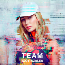 "A portrait of a young woman with blonde hair looking straight at the camera, with a white cap. At the bottom center stands the song title, ""Team"", and the artist name, Iggy Azalea."
